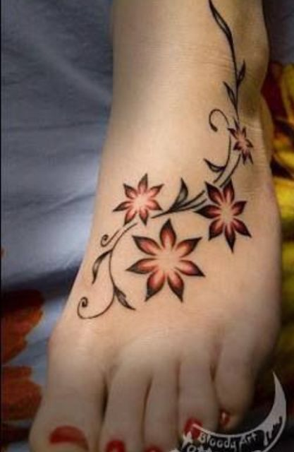 Awesome Shining Flowers Foot Tattoo
