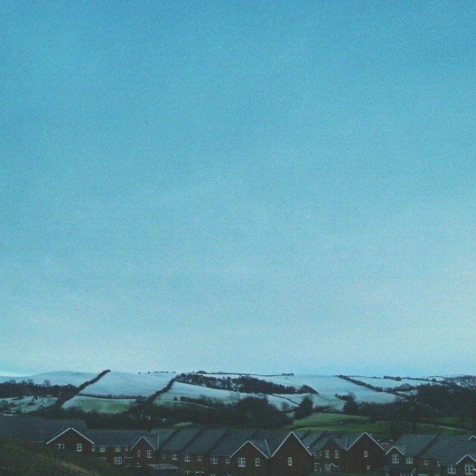 Imagine: on a day like this spend the #evening by a real fire with real friends. .. #dreams #snow #winter #cold #gloomy #imagine #hills #newtown #powys #cloudy #skies #houses #NewtownPowys  - LinanDara's Art-n-Folk