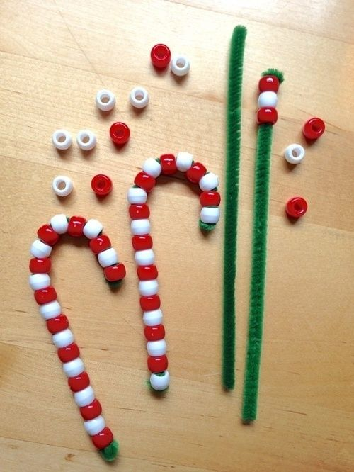 Genius idea for festive crafts and fine motor control skills, and because the pipe cleaners are fluffy, the beads won't just slide off again. Love it!
