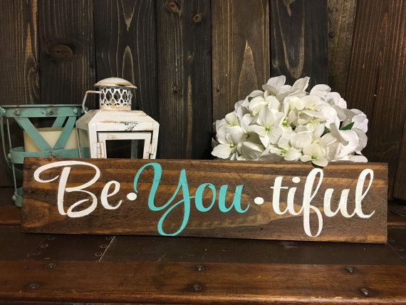 This rustic Be You Tiful Sign is perfect for your childs room or nursery. It is the perfect motivational sign for anyone who needs the reminder to be themselves! All our signs are made with naturally aged, distressed reclaimed wood. Pictured sign is stained with dark walnut, hand painted with turquoise and white lettering, and sealed so it will last for years to come. Your sign will come ready to hang with a sawtooth hanger attached on the back. Dimensions are approximately 16 x 3 1/2…