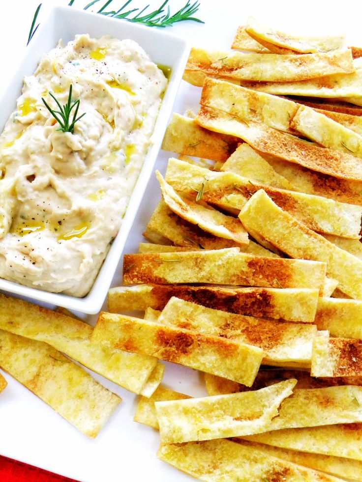 Now this is my absolute, go to, hands down, favorite appetizer dip! Rosemary Olive Oil Pita Strips with Tuscan White Bean Dip. I can't tell you how many times I've made this for a party, the recipe comes from my friend Jean, you can make a ton for practically pennies!