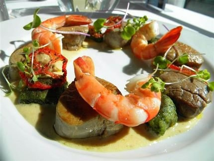 Fillets of Veal with prawns on Dijon mustard sauce and potato gnocchi complemented by roasted red peppers.