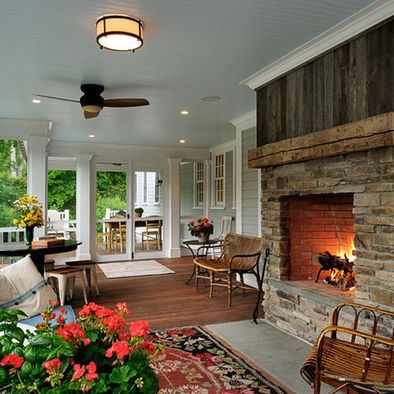 Traditional Porch Fireplace with Flat Stone and Barnwood Boards above Mantel