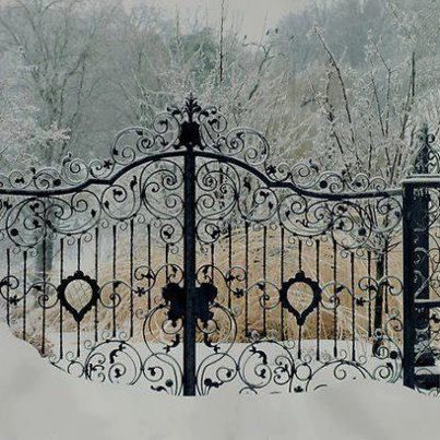 Antique iron gates lead to an unbelievable residence...