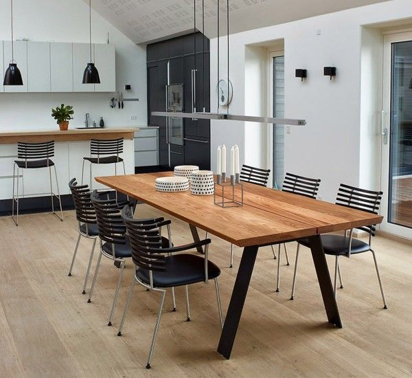Plank Table is designed by Nissen & Gehl for Naver Collection, made of solid wood with legs in burnished steel.