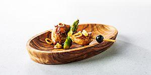 Kipdijfilets, chorzio en asperges maken het hapje Saciar tot een ware delicatesse.