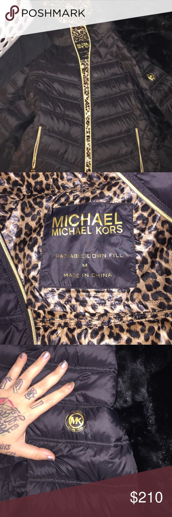 Auth. Michael Kors Down Puffer Silky black exterior with stunning gold zippers & gold dangle MK charms on each zippered pocket (two) and main zipper! Silky leopard interior, & fitting hood. MK logo in gold on left arm, filled with soft down, but a comfortable amount - not so much you look bloated! Overall great condition with a few tiny pinholes where down occasionally slips out, but was purchased this way and is common to occur. Does NOT impact wearability or function! Little coat hanger…