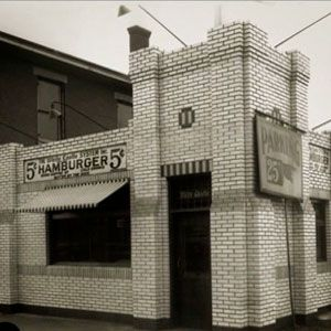 The restaurant 'White Castle' is Americas oldest and 1st hamburger chain. This photo is the original White Castle  location that made fast food history.
