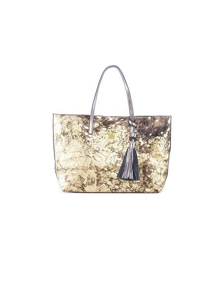 Carolina Crowley cowhide gold tote bag with hand painted fur detailing, straps and tassel detailing. Made in Mexico. Handmade.