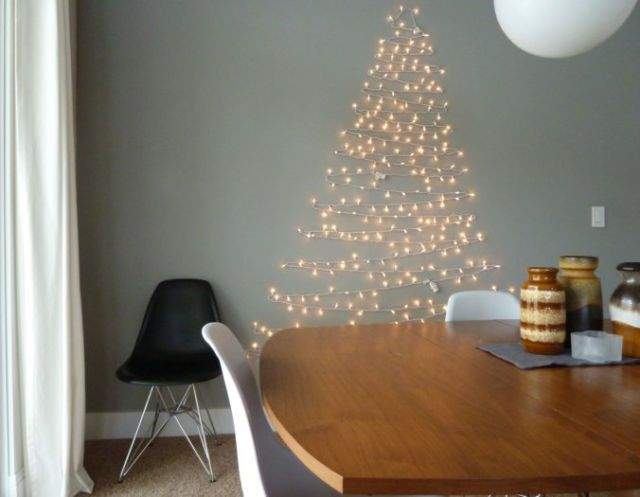 Everyone has a string of fairy lights knocking around, and with a bit of creative placement, you can turn yours into some cool christmas tree wall art!(see the tutorial) -Cosmopolitan.co.uk