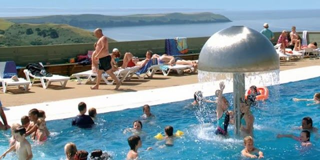 Have it all! a swimming pool with a sea view just round the corner from the renound Woolacombe beach.  Woolacombe Bay Holiday Park   https://www.campsitechatter.com/campsites/pinboard/Woolacombe-Bay-Holiday-Park/5772229778202191281