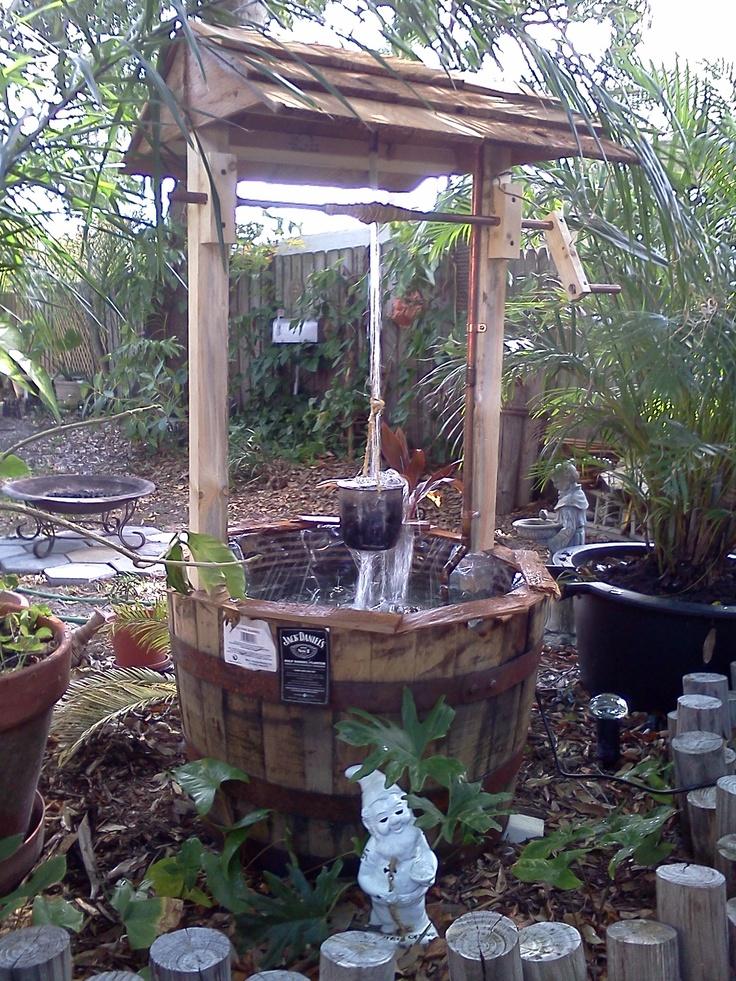 Jack daniel 39 s distillery barrel wishing well fountain for Garden well designs