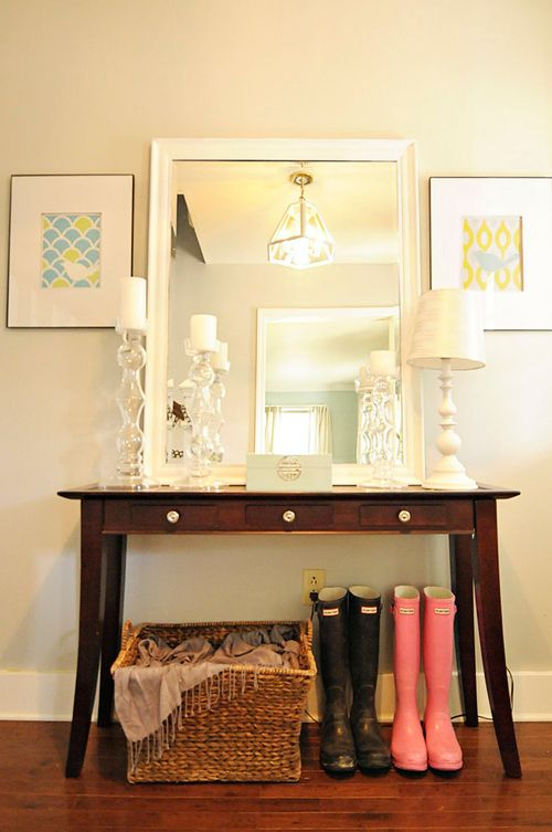 Big mirror on an entry table. Like everything, but maybe add a shoe rack underneath so right when you walk in the door everyone could out their shoes there!