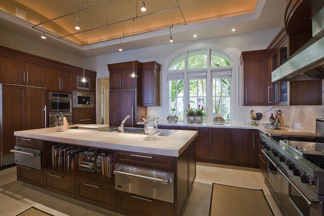 : Glorious Craftsman Home Kitchen Idea Integrating Wide Island With Sink And Bookcase And Square Track Lighting Pendants