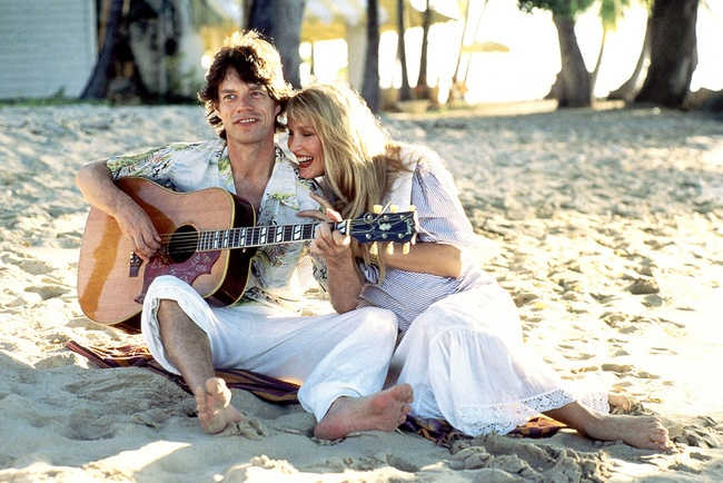 Jerry Hall and Mick Jagger on the beach in Mustique, when she was pregnant with Elizabeth.