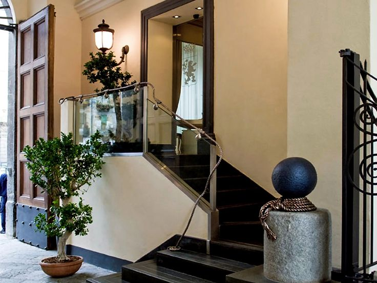 Doorway of the conference room. Palazzo Caracciolo, Naples (Italy)
