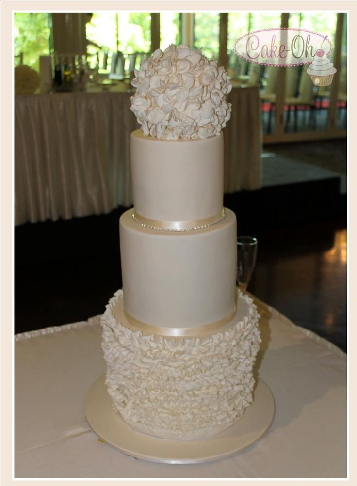 Three tier fondant ruffle wedding cake in ivory