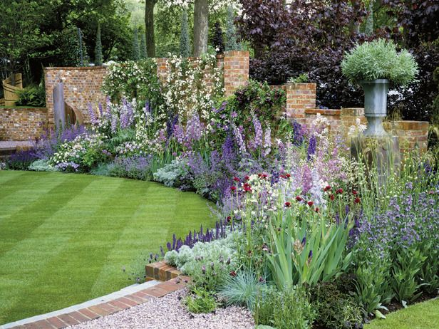 A brick wall and structured lawn create a foundation for this gorgeous cottage-style planting bed.: Cottages Style, Cottages Gardens, The Colors Purple, Colors Combinations, Colors Schemes, Gardens Spaces, Gardens Border, Gardens Design, Border Gardens