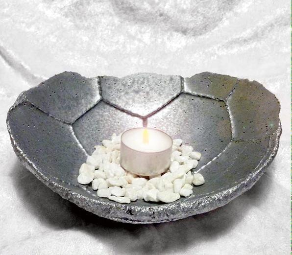 Gjut en betonglykta av en fotboll