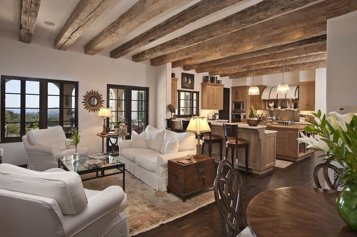 Cottage Great Room with Pottery barn - gold sunburst mirror, French doors, Pottery barn - comfort roll sofa, Exposed beam