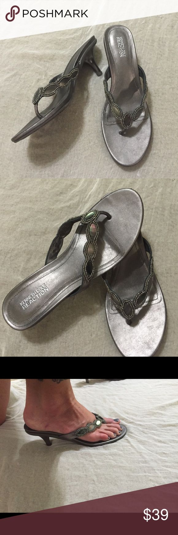 Lovely Kenneth Cole metallic pewter sandals Lovely Kenneth Cole reaction pewter sandals with kitten heels! The straps are embellished with pewter beads and dark abalone. Comfortable and easy to wear with pants or skirts!! Used once. ❤️ Kenneth Cole Reaction Shoes Sandals