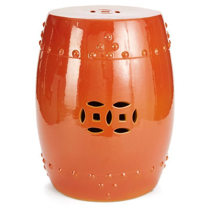 Our Orange Crackle Garden Stool makes a vibrant and sculptural accent piece for your home. This ornate ceramic garden stool features a pierced medallion, embossed Chinese vessel nailheads, and a glossy orange finish. Use this stool for extra seating, side table or plant stand indoors or out.