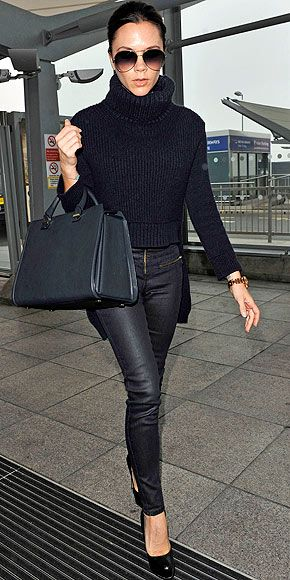 Victoria Beckham...all from her own design lines – with a cropped knit turtleneck and rose gold watch.