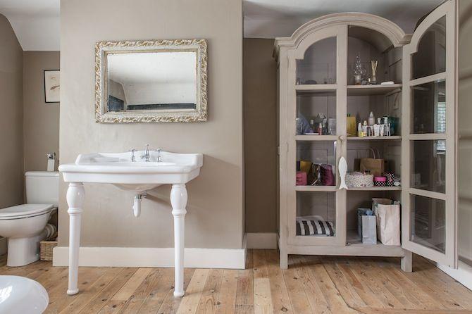 Elegant bathroom painted in Farrow & Ball London Stone.