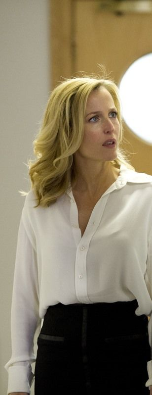 Sleek Stella Gibson wearing one of her trademark silk blouses & pencil skirts