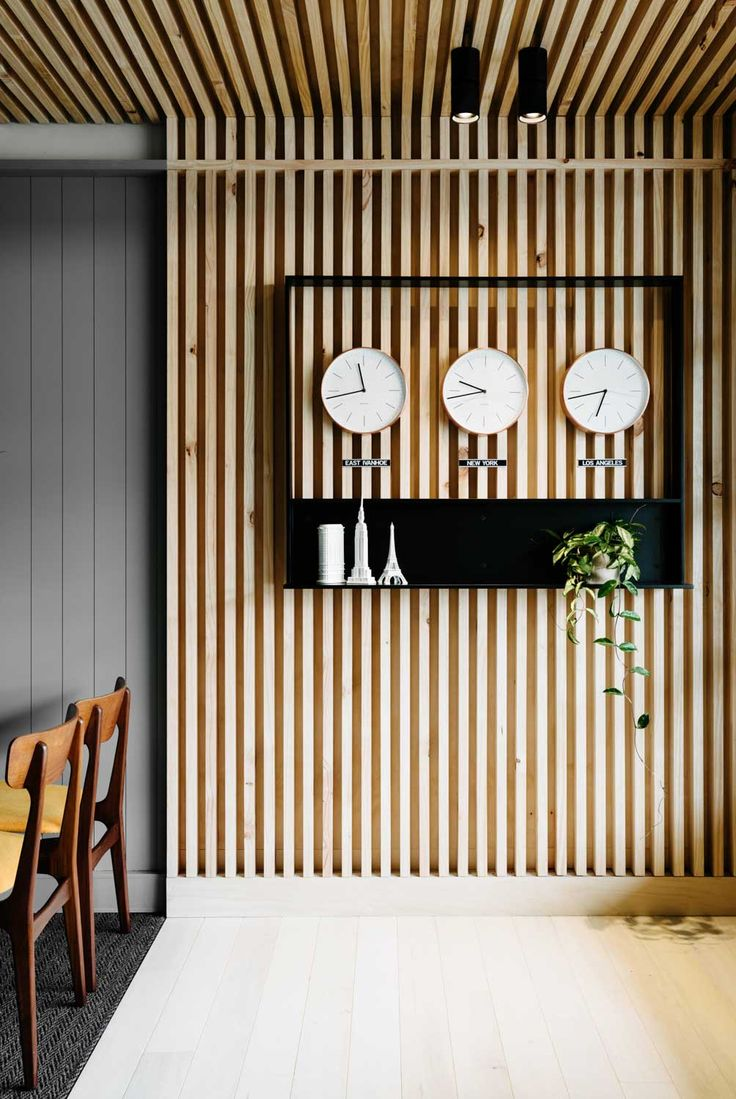 Travel Shop by Flack. Thin planks set together vertically to create an interesting wall fixture that goes up onto the ceiling.