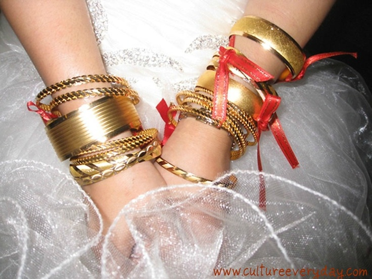 In Turkish culture, it's customary to gift the bride with gold bangles on her wedding day.