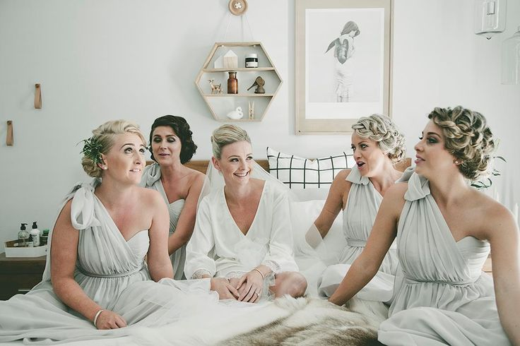 Bridesmaids in grey with floral crowns