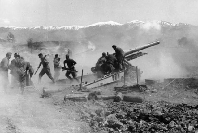 World War II: Battle of Greece: German artillery fires during the advance through Greece, 1941