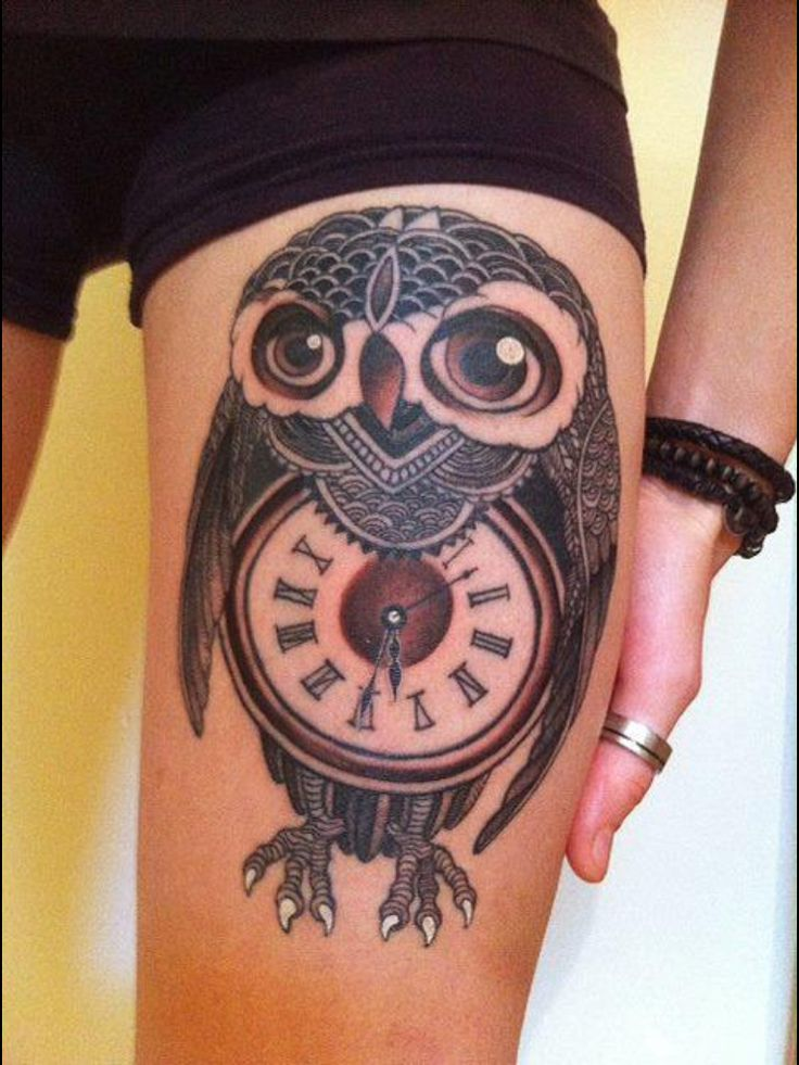 Owl tattoo with compass instead of clock