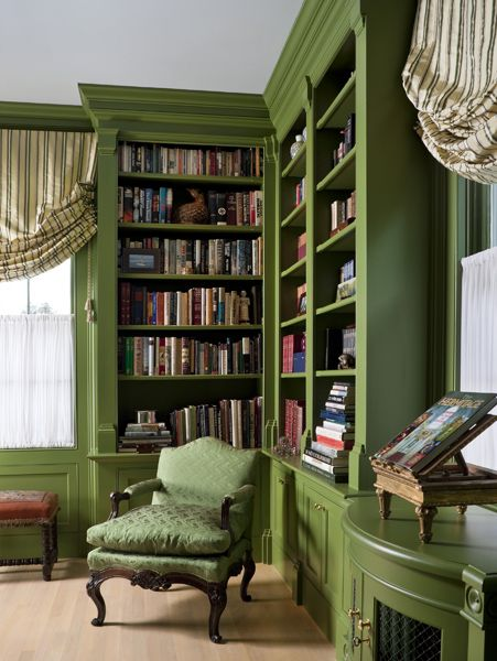 Unusually calming green tone bookcase.  A great reading corner.  I'd change the chair color to a vintage red tone or maybe slight tangerine orange!   And add my own diamond button tufted distressed black leather round ottoman too.   #PerfectPerch