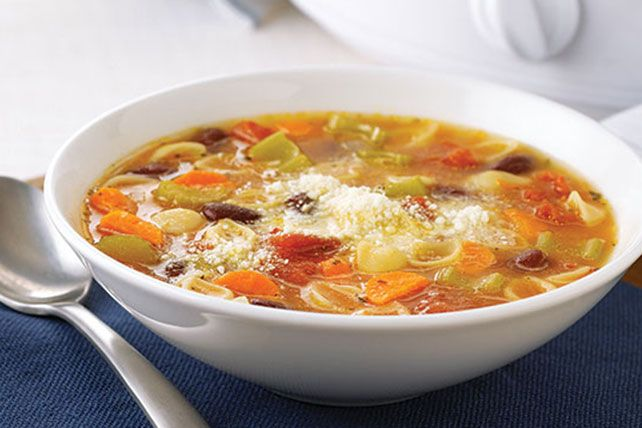 Enjoy veggies and warm pasta in this slow-cooker Minestrone Soup! Prepare this vegetarian version of an Italian classic for a dish everyone will love!