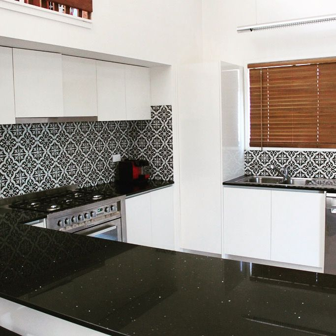 This kitchen never had a pantry prior to remodel. We overcame some restrictions and fitted one in. The client was delighted. #brisbanekitchendesign #brisbanekitchensolutions #engineeredquartz #kitchendesign #smallpantry #kitchensolutions #fingerpullhandles #blackandwhitekitchen #brisbanebuilder www.brisbanekitchensolutions.com.au