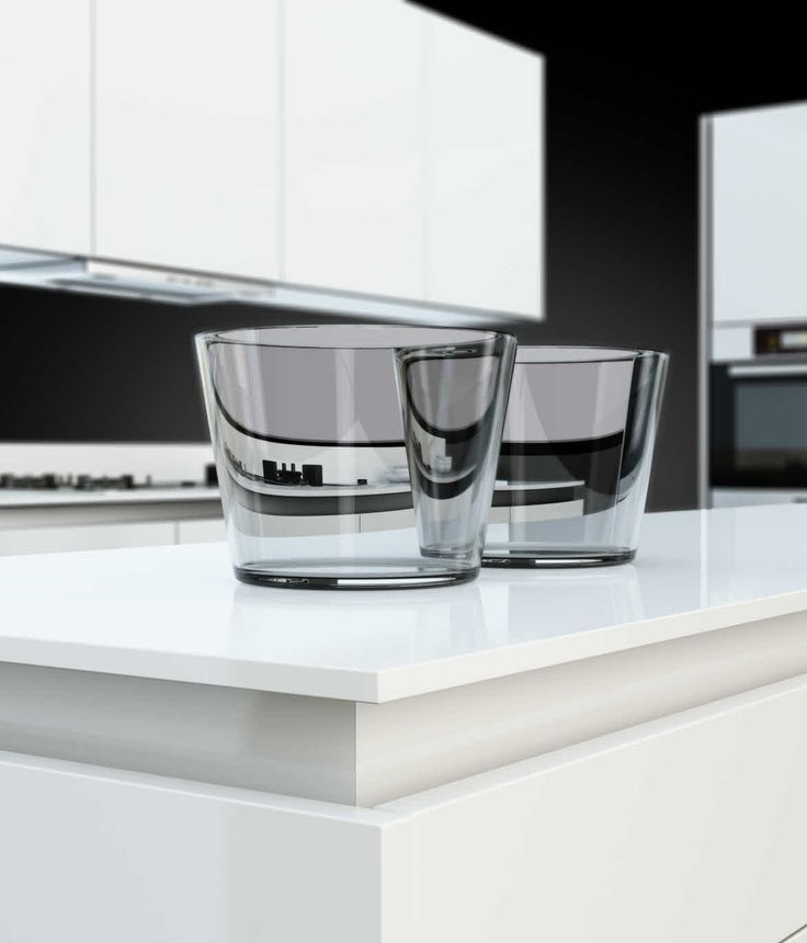 The Poggenpohl +SEGMENTO polar white worktop is just 12mm thick, giving the impression that it floats above the units beneath.
