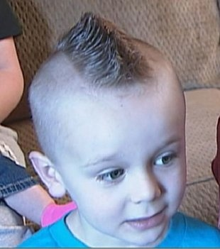 """FASHION POLICE. Ethan Clos, 5, was suspended from kindergarten after he showed up with this hairstyle. Superintendent Gregg Morris says they had to send little Ethan home. """"Our dress & grooming policies... ensure that clothing & hairstyles do not cause a distraction to the learning environment,"""" The school's handbook: """"Hair shall be worn above the eyebrows & must be kept clean, neat & trimmed"""" & specifies that boys may not wear their hair longer than the bottom of their shirt collars..."""
