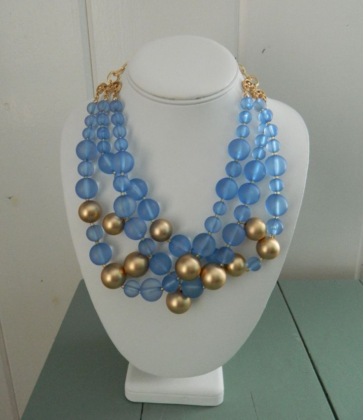Gold is all the rage this season. You can pair it with anything. This statement necklace is fabulous. We love the sea glass blue beading- perfect for summer! But, the gold ties it back and makes it gr