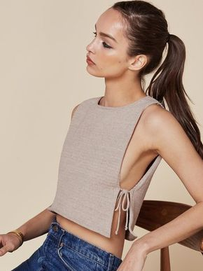 Air it out. This is a cropped top with open sides and side ties.