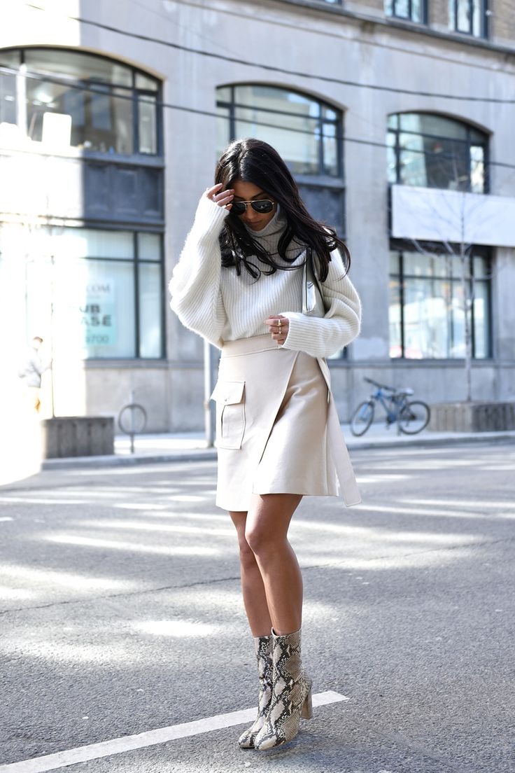ivory turtleneck + skirt and snake print ankle boots #streetstyle for more findings pls visit www.pinterest.com/escherpescarves/