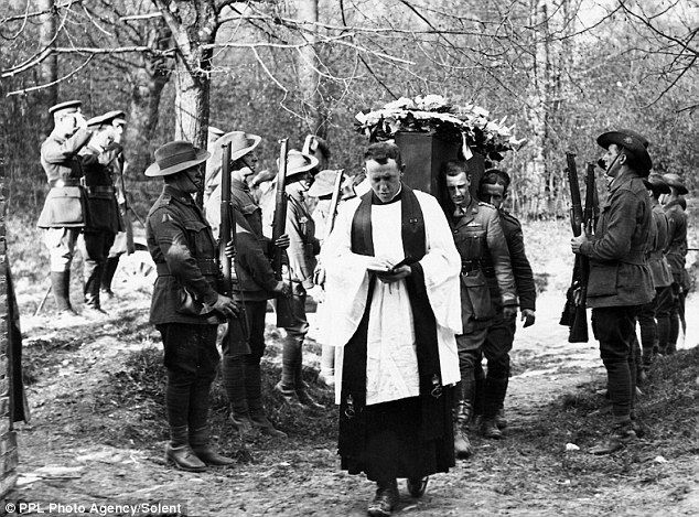 The coffin of Baron Manfred von Richthofen's (The Red Baron) is carried into the cemetery at Bertangles by six pilots of No.3 Squadron, Australian Flying Corps, 22 April 1918...