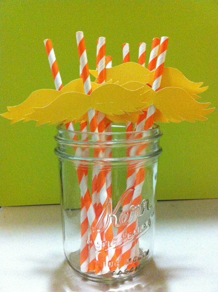 Lorax Mustache Straws: i made the mustaches using a template i found online then hot glued the mustaches to orange striped paper straws.I love the way they came out!!! Party guests will love these!