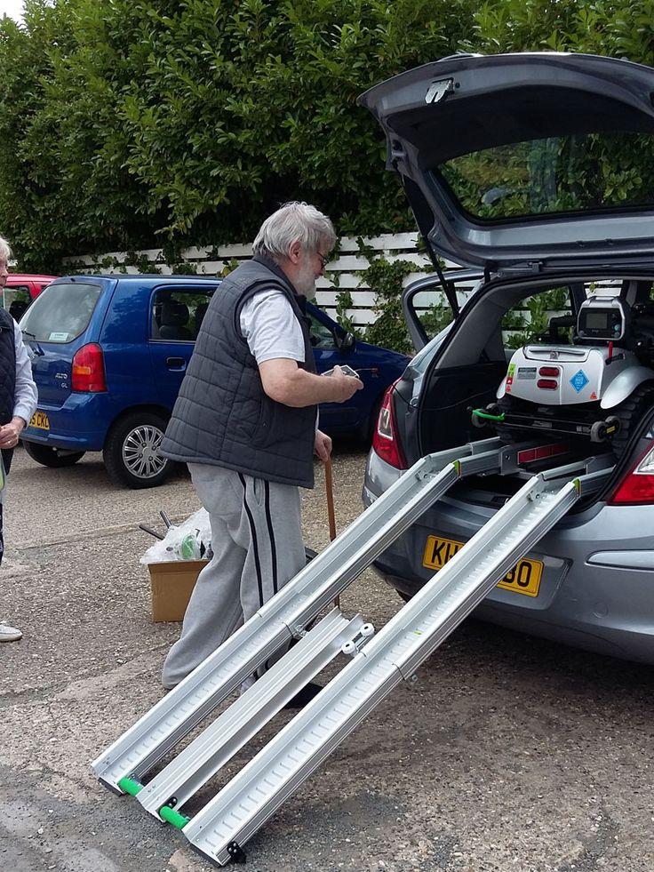 Mr Tom Fogarty loading his Flyte mobility scooter www.quingoflyte.co.uk