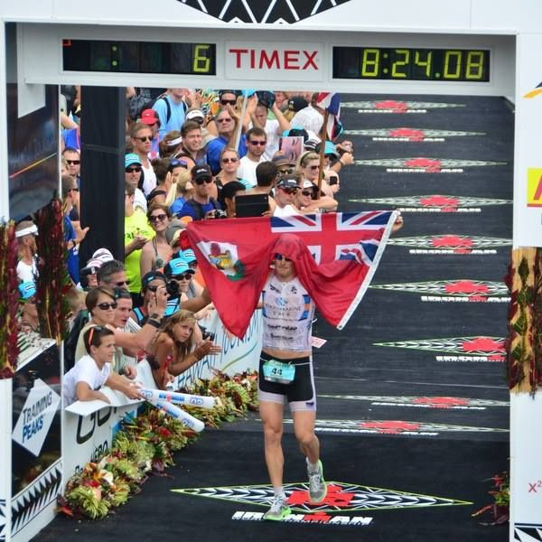 #Bermuda's Tyler Butterfield made a very strong showing in this weekend's Ironman World Championship in Hawaii, claiming a 7th place finish in a field of over 2,000 athletes.The photo below [courtesy of FinisherPix] shows him crossing the finish line with the Bermuda flag. http://bernews.com/628a