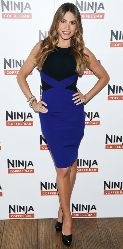 As the face of Ninja Coffee Bar, Sofia Vergara promoted her latest venture in a curve-hugging cobalt blue-and-black sheath, complete with an arm party stack of bracelets and black platform Louboutins.