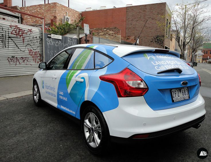 Car Real Estate: Ford Focus, Real Estate, Partial Vehicle Wrap, Real Estate