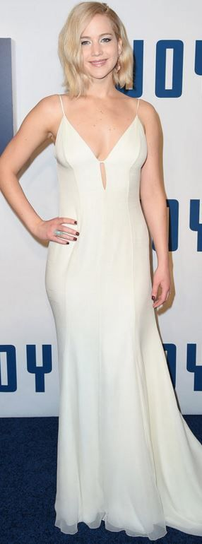 Who made Jennifer Lawrence's white gown and jewelry?