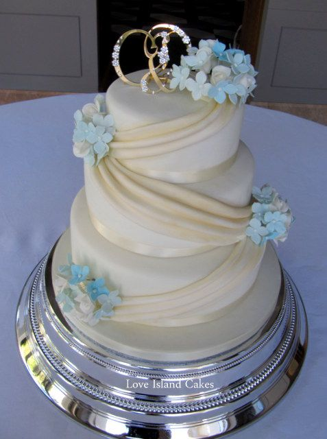 BLUE HYDRANGEAS IVORY ROSES WEDDING CAKE Ivory And Gold Lustred Cake With Sugar Swags